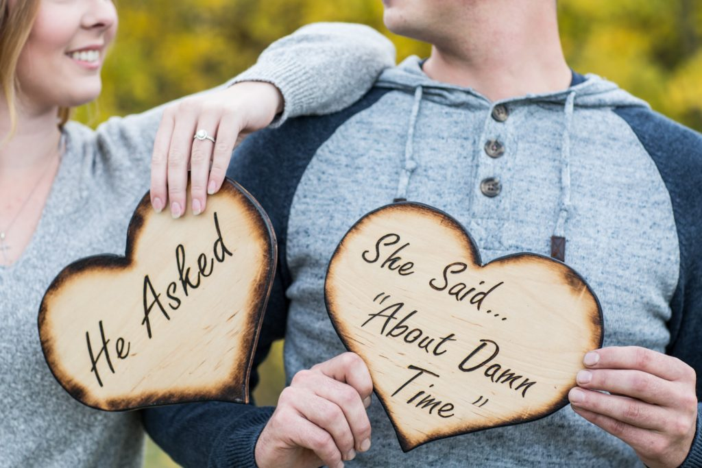 Snow Valley Engagement Photos with couple holding hand made signs