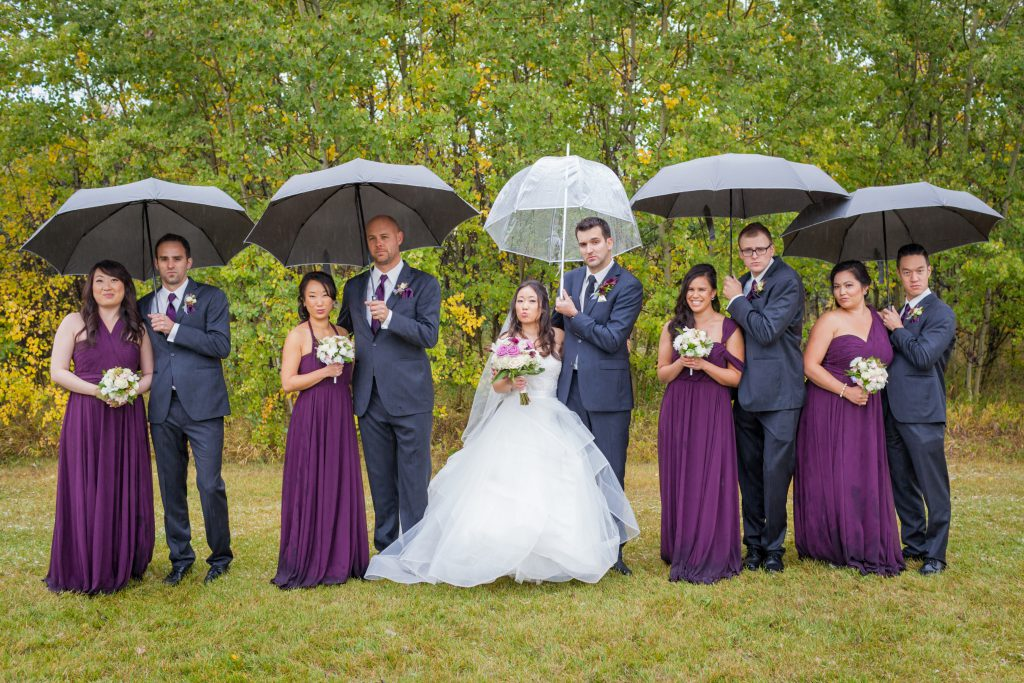 fun wedding party photos in the rain