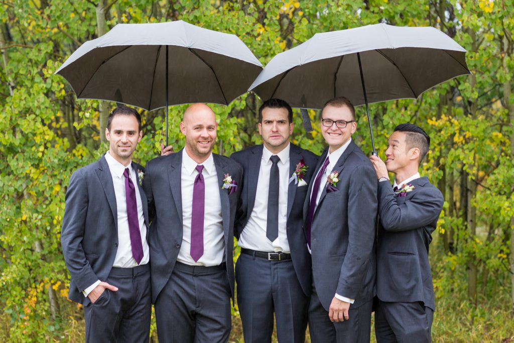 groomsmen wedding photos in the rain