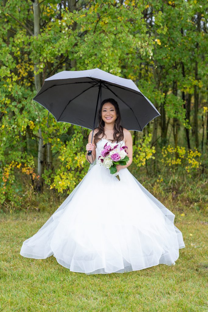 bridal portrait in the rain