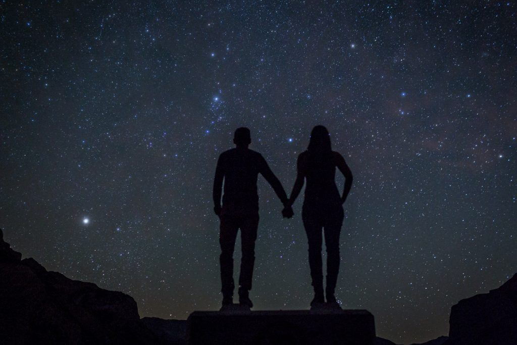 Mountain engagement photos with the night sky full of stars