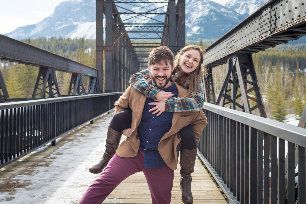 fun winter engagement photos in canmore