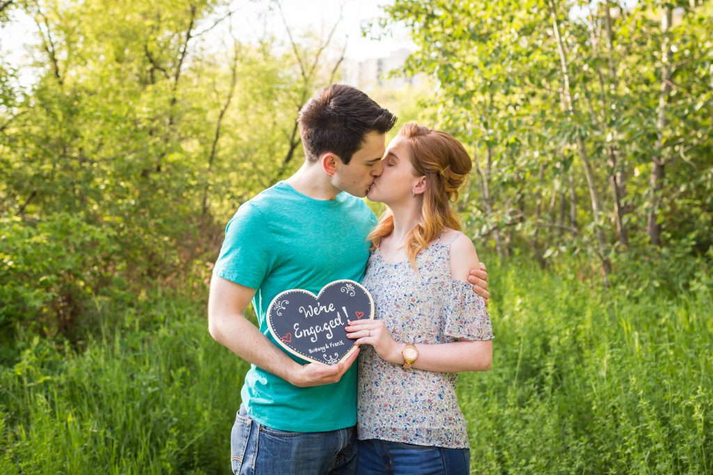 engagement photos with chalkboard sign