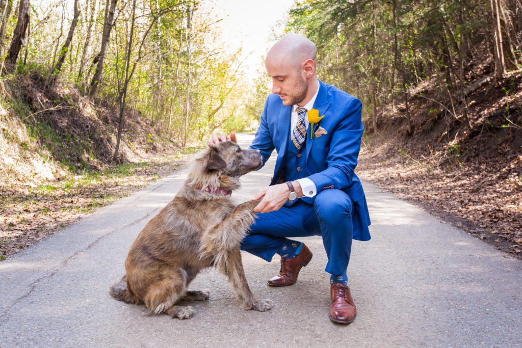 groom portrait with dog