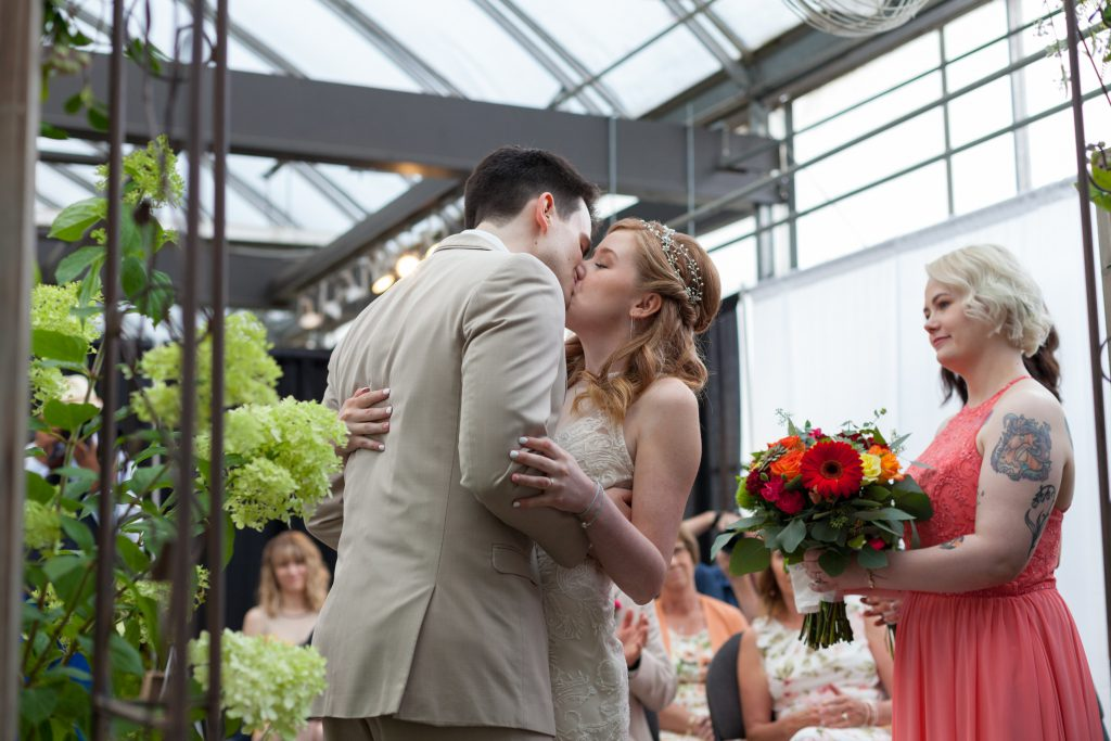 photo of wedding first kiss