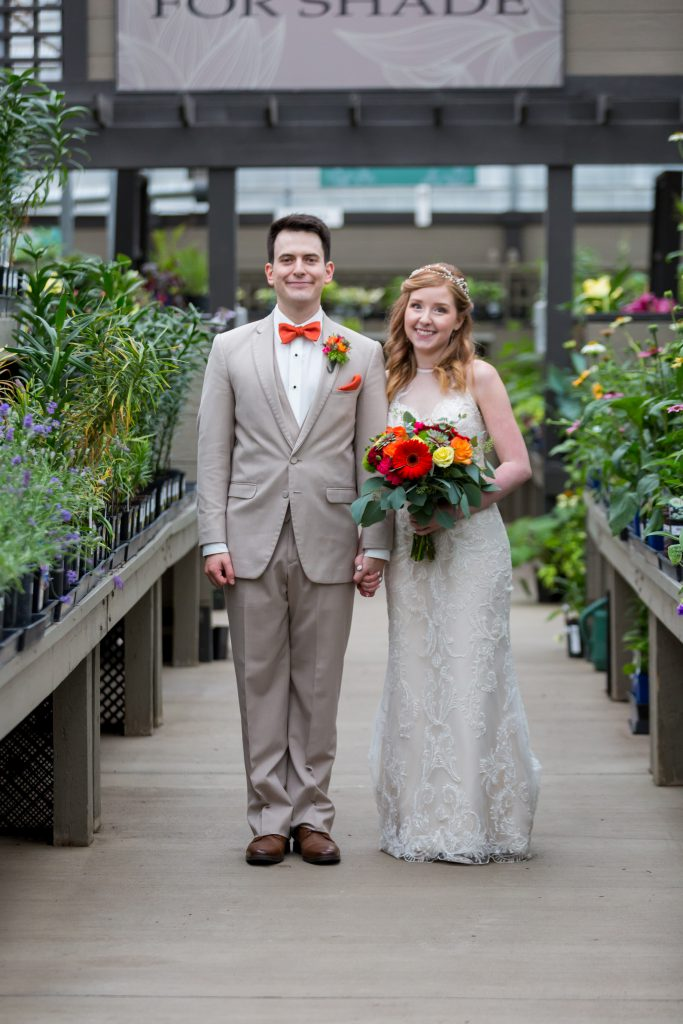 greenhouse wedding photo of bride and groom