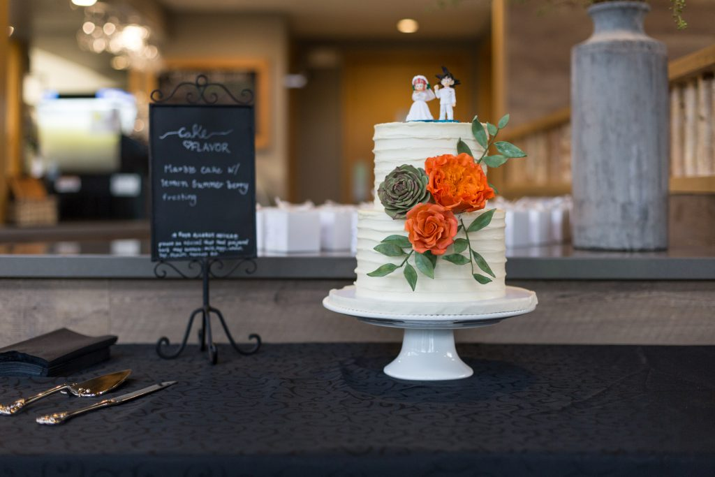 orange and green sugar flower wedding cake