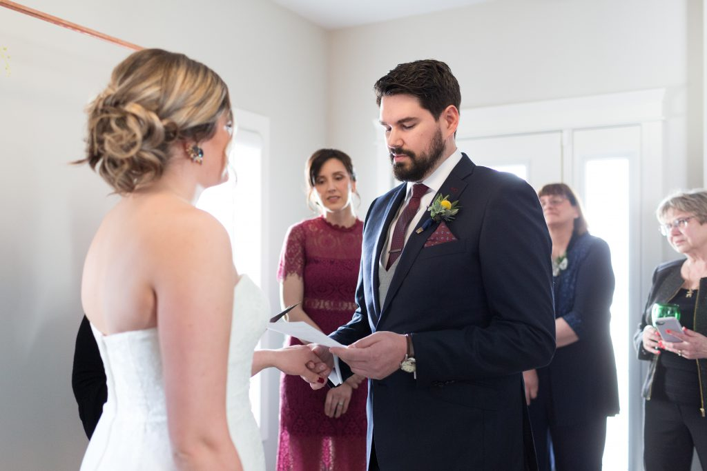 groom reading wedding vows