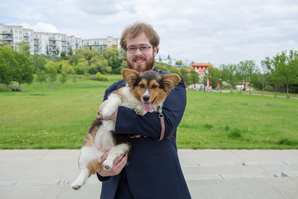 Groom and his corgi